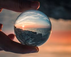 Glass ball in hand